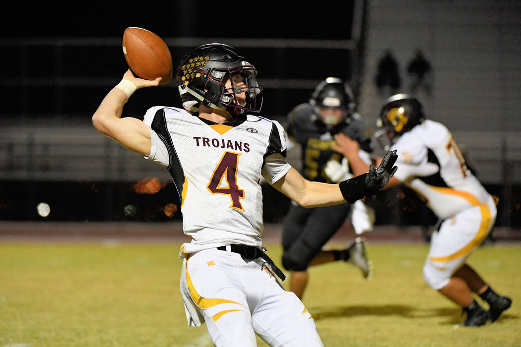 Peter Davis/Special to the Pahrump Valley Times  Senior Trojans quarterback Dylan Coffman is seen under pressure from the Sunrise Mountain defense last Friday. He hopes to have a better day agains ...