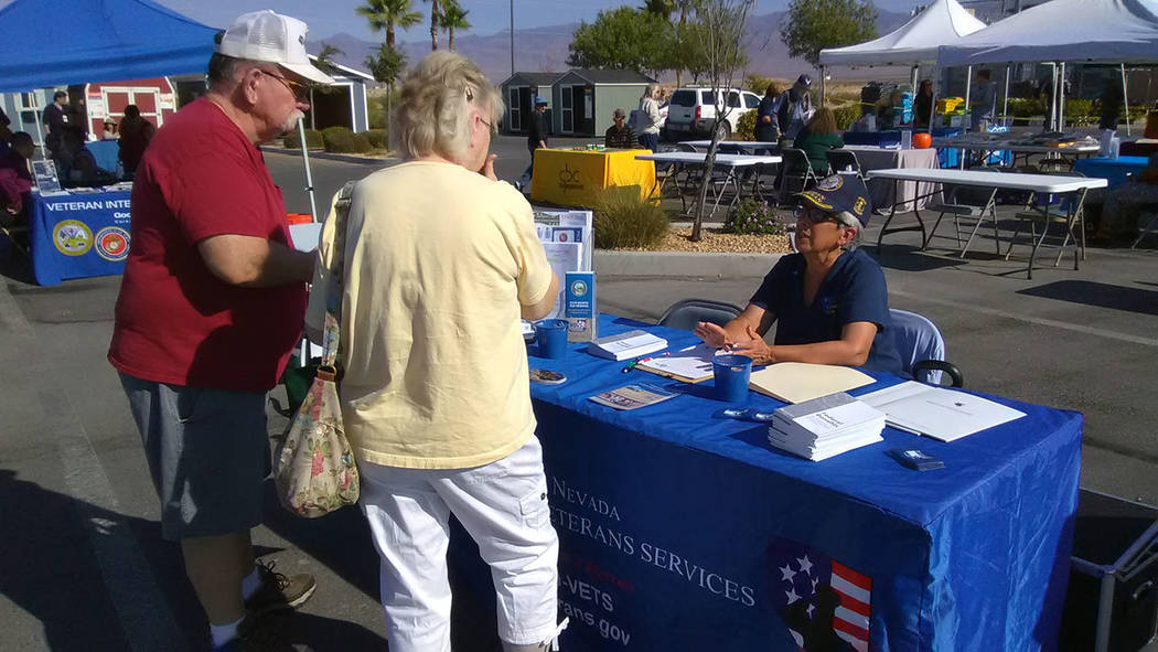 Selwyn Harris/Pahrump Valley Times  Susan Moore, a volunteer for the State of Nevada Department of Veteran Affairs Services provides information to a local veteran and his wife. The agency has bee ...