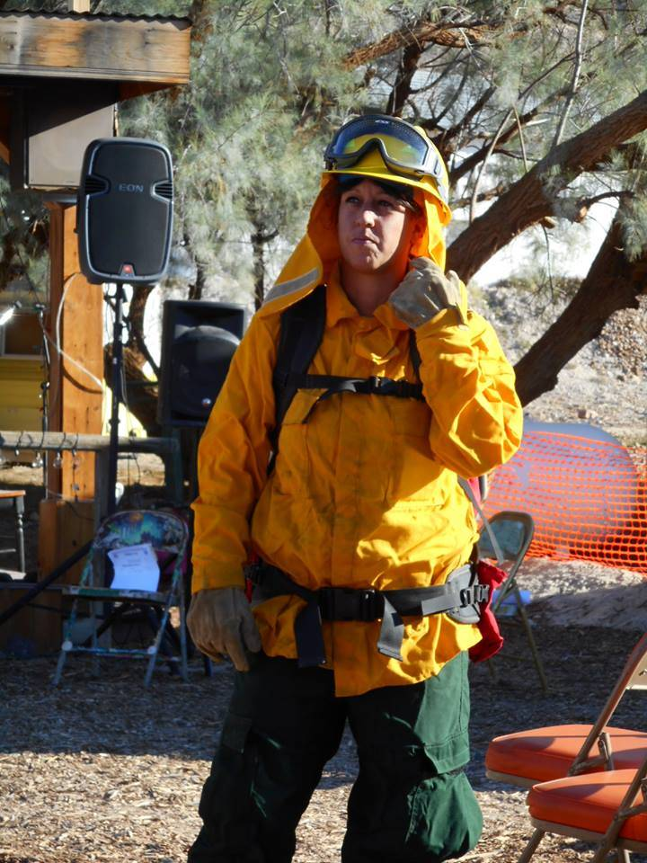 Southern Inyo Fire Protection District Firefighter Angie Sinhoui in wildland gear at 2016 SIFPD fundraiser.