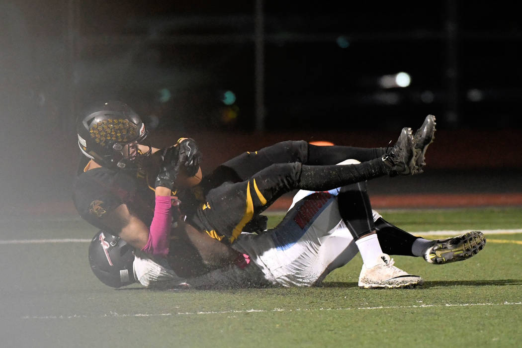 Peter Davis/ Special to the Pahrump Valley Times At left, Senior receiver Cory Bergan comes down with the ball in the end zone for a 33-yard TD reception against Western on Friday night. The Troja ...