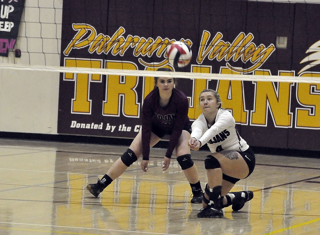 Horace Langford Jr./Pahrump Valley Times  Junior Sabin Chaidze digs one out as Trojans libero, sophomore Madison Hansen, looks on.