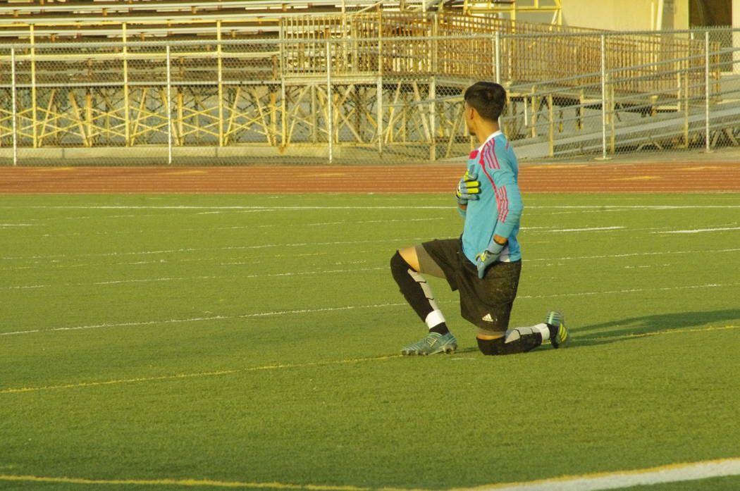 Vern Hee/Pahrump Valley Times  The Desert Pines goalkeeper takes a knee during the national anthem on Oct. 17 at Pahrump. The school said they were unaware of his protest and refused to comment.