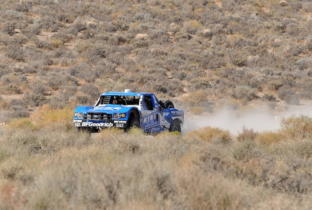 Horace Langford Jr./Pahrump Valley Times -  Jason Voss in his number one Blue King Shocks truck is seen speeding through the desert during the Vegas to Reno Race in August. He took first place in  ...
