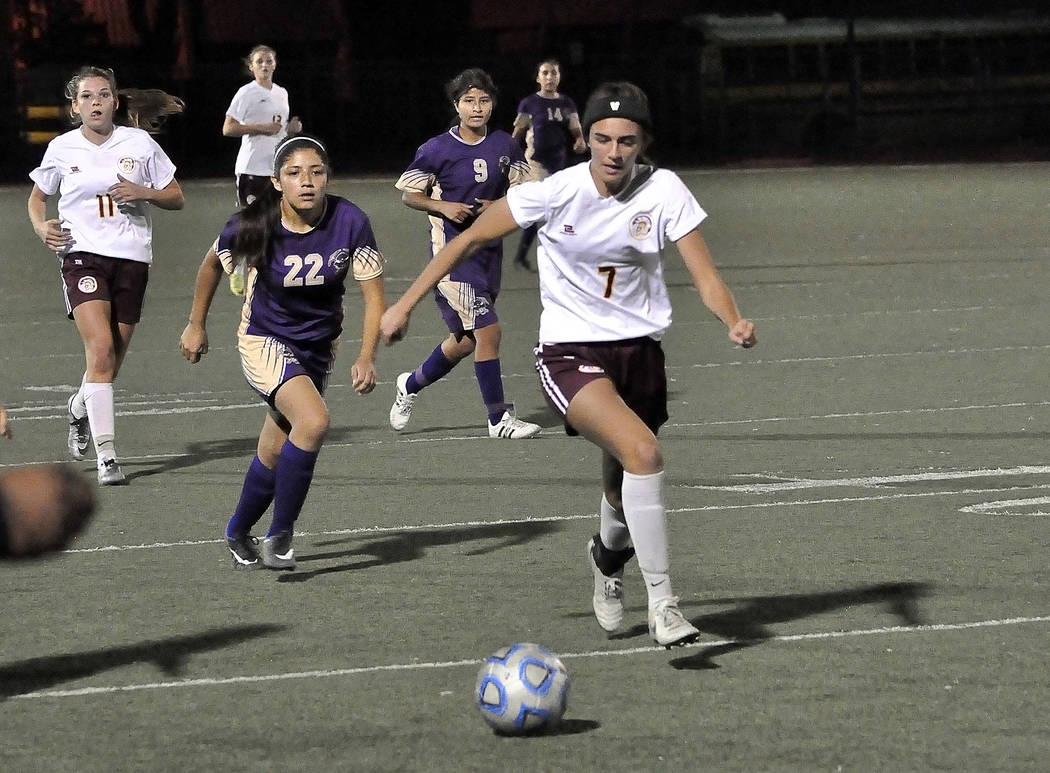 Horace Langford Jr./Pahrump Valley Times Senior Vaniah Vitto races after the ball at the Sunrise Mountain game on Wednesday night. The girls finished the game with a 0-0 tie.
