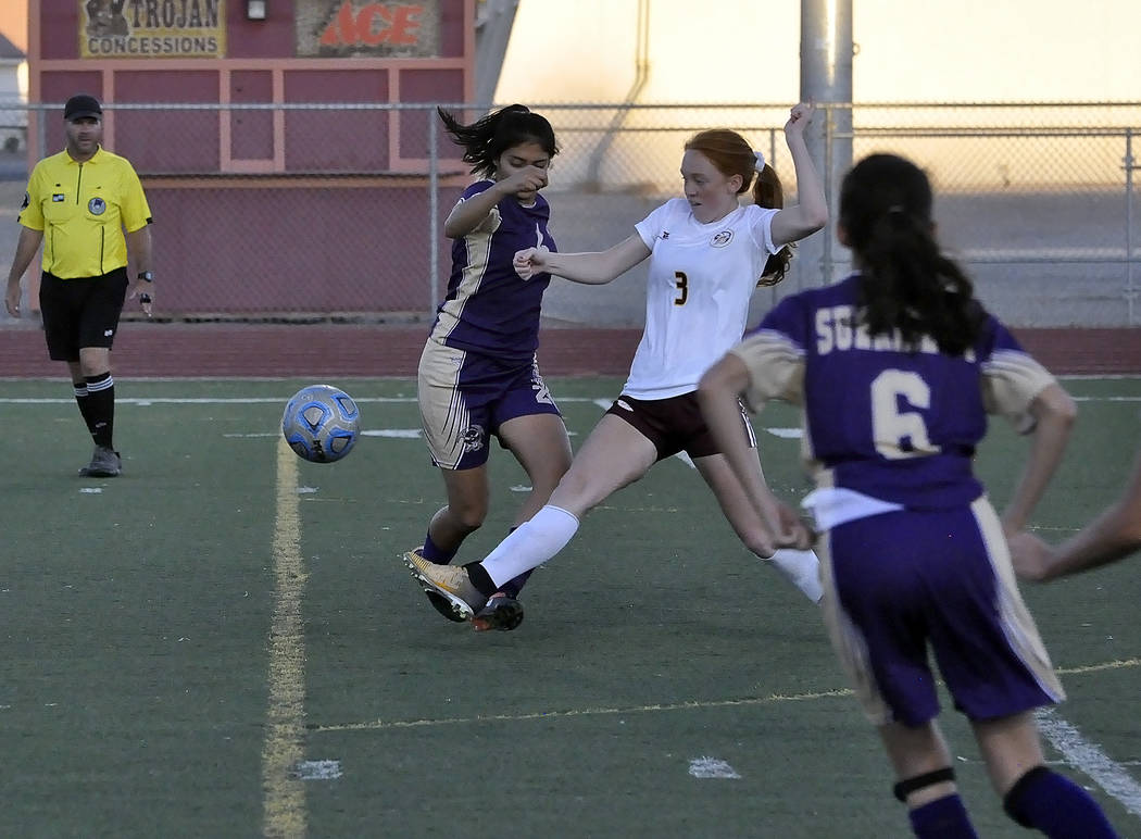 Horace Langford Jr./Pahrump Valley Times Senior Kaitlyn Carrington attacks the ball during the Sunrise Mountain game on Wednesday. The team tied the Miners 0-0 but advanced as the number one seed  ...