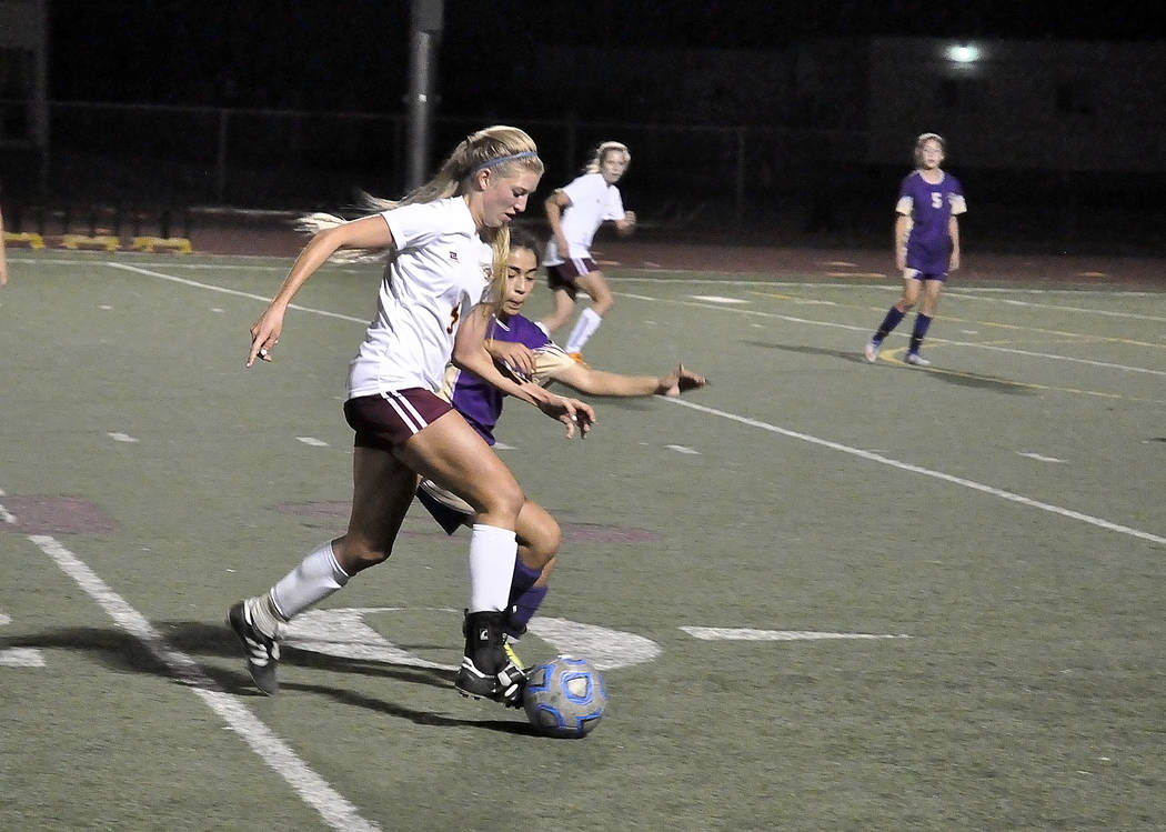 Horace Langford Jr./Pahrump Valley Times Senior Sydney Dennis takes the ball downfield against Sunrise Mountain on Wednesday night. The girls will play Virgin Valley in Summerlin at Bettye Wilson  ...