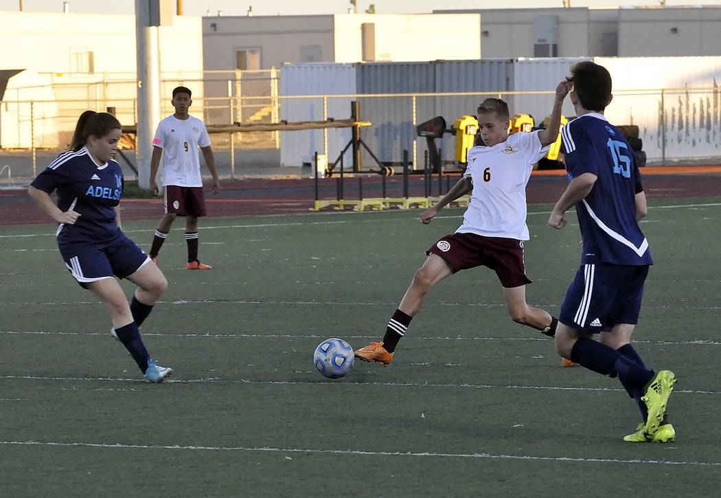 Freshman Vincent DiBlasi makes a lunge for the ball against Adelson on Monday. The Trojans ended the year, losing to Sunrise Mountain on Wednesday.