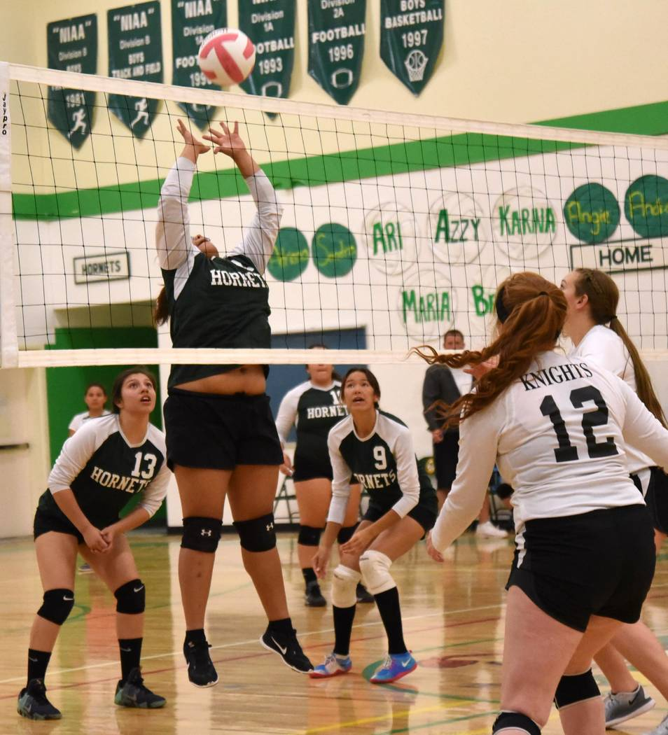 Richard Stephens/Pahrump Valley Times Sandra Garcia tips the ball over the net against Round Mountain during homecoming week. The Hornets hosted their last game of the regular season against Pahra ...