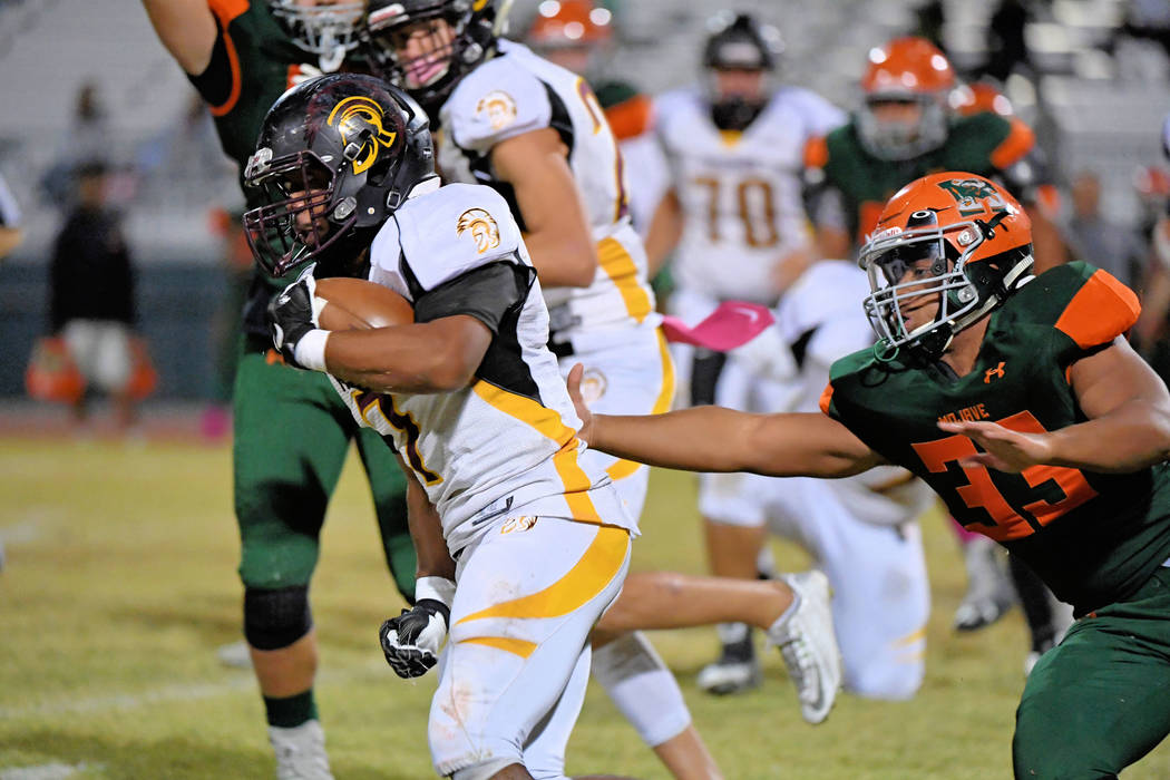 Peter Davis/Special to the Pahrump Valley Times DeAngelo Brown breaks through the Mojave line in last week's game. Virgin Valley is also a hard running offense. The Trojans need to contain the Bul ...