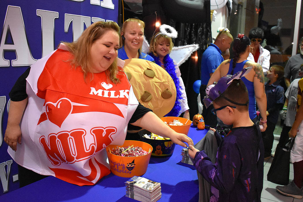 Daria Sokolova/Pahrump Valley Times Representatives of Nevada Realty, a real estate agency from Pahrump were among several businesses that took part in Saturday's Halloween event that was put on b ...