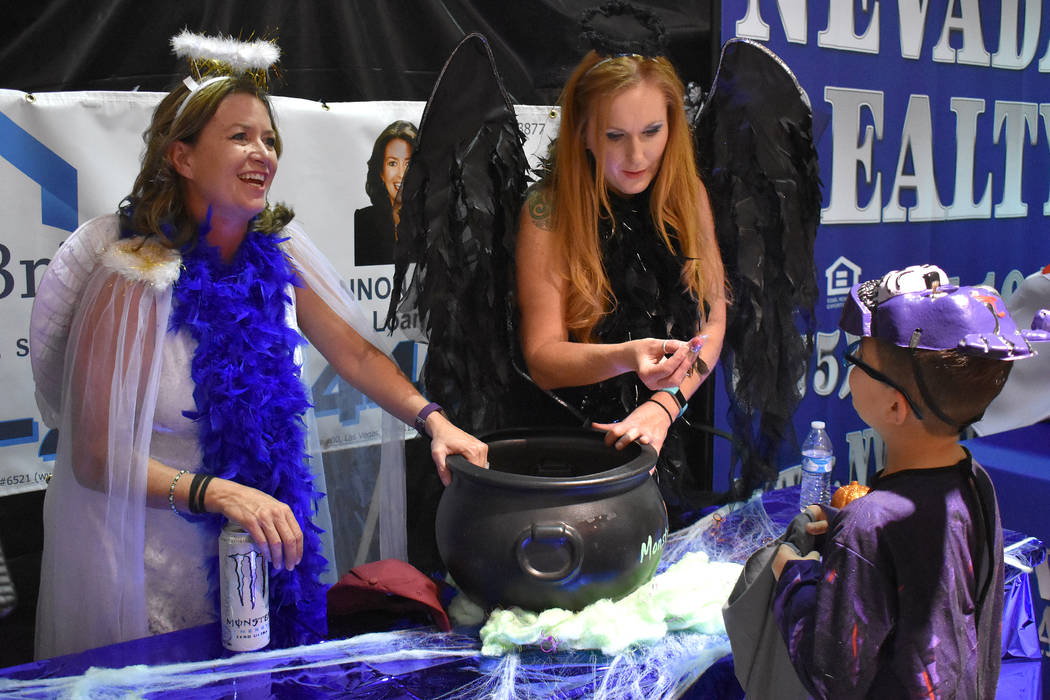 Daria Sokolova/Pahrump Valley Times Representatives of Financial Bridge were among several businesses that took part in Saturday's Halloween event that was put on by the Pahrump Valley Auto Plaza.
