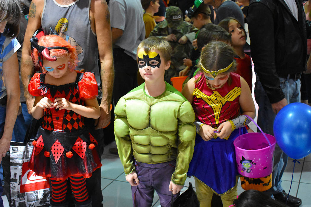 Daria Sokolova/Pahrump Valley Times Hundreds of trick-or-treaters and their parents descended on the Pahrump Valley Auto Plaza Saturday night during the fourth annual Halloween event.