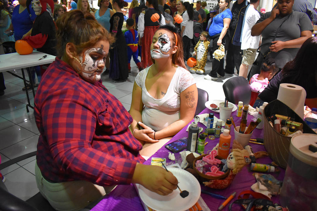 Daria Sokolova/Pahrump Valley Times A Halloween participant is having her face painted during the fourth annual Halloween at the Pahrump Valley Auto Plaza. The three-hour event brought hundreds of ...