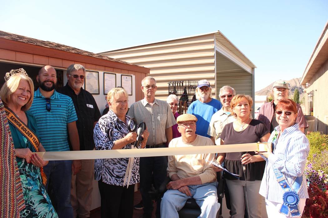 Jeffrey Meehan/Pahrump Valley Times Jessica and Mike Wakefield, owners of Silver State Traders in Pahrump, were welcomed to the Pahrump Valley Chamber of Commerce with a ribbon cutting ceremony on ...