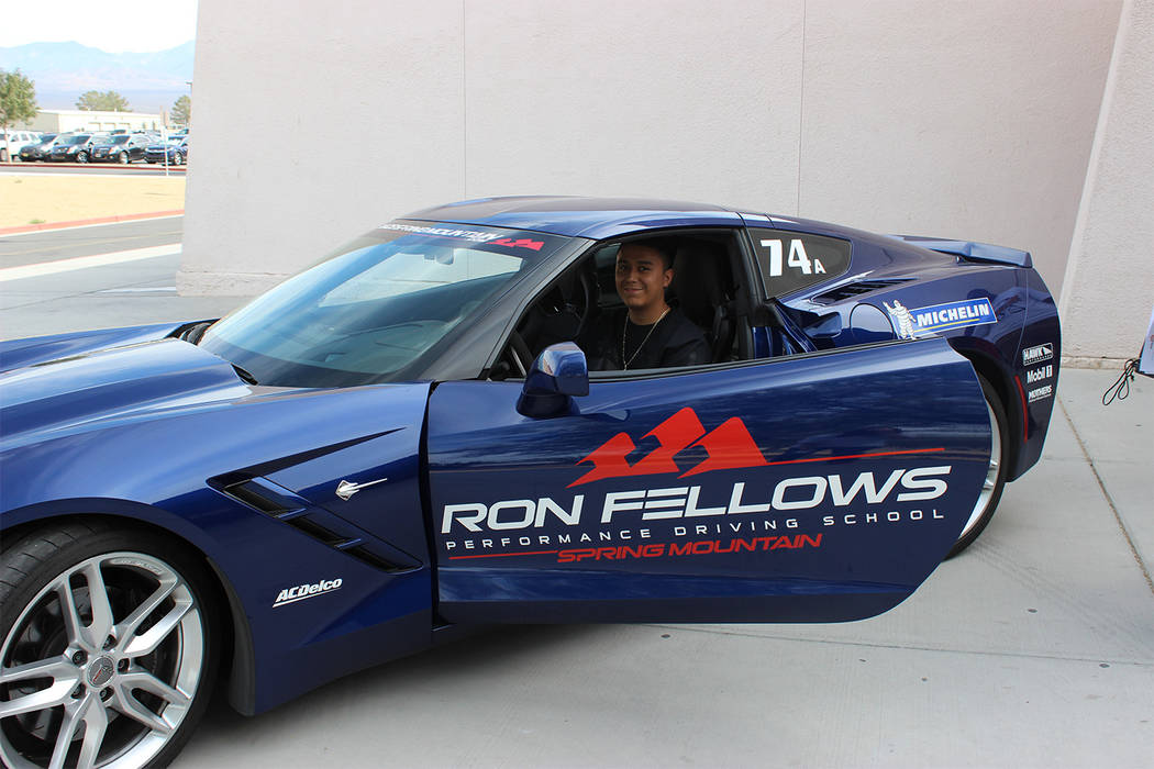 Special to the Pahrump Valley Times Junior Pedro Carranza dreams of his future as he sits in a corvette from Spring Mountain Motorsports Ranch. Spring Mountain came to the career day to talk to th ...