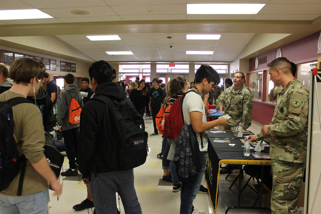 Special to the Pahrump Valley Times Junior and senior students crowd into the Pahrump Valley High School gym for the Gear Up college and career day fair. Students came from as far away as Round Mo ...