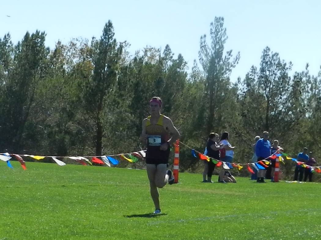 Special to the Pahrump Valley Times  Defending state champion senior Bryce Odegard (17:36) crosses the finish line as the regional champion. Odegard and the boys and girls team will travel to Spar ...