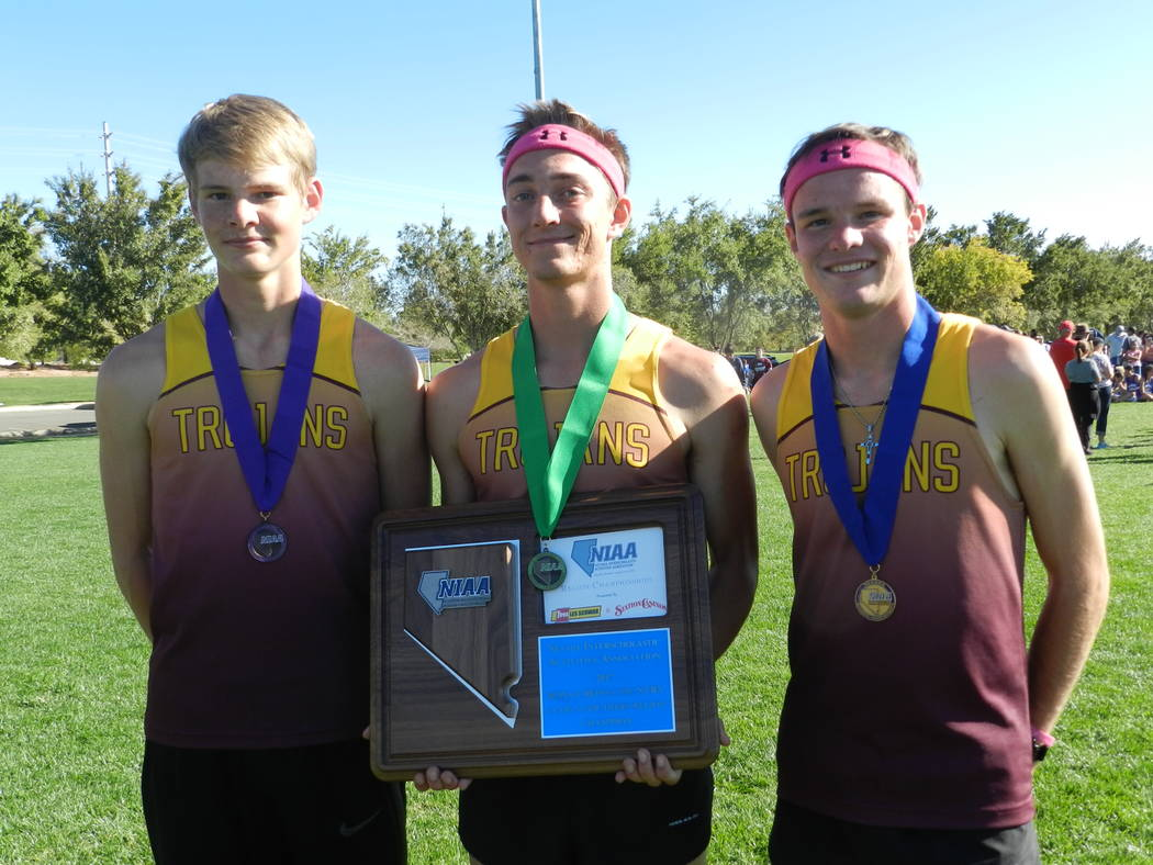 Special to the Pahrump Valley Times  Medalists for the Trojans from left to right, sophomore Grant Odegard finished sixth, senior Cole Goodman finished fifth and senior Bryce Odegard finished first.