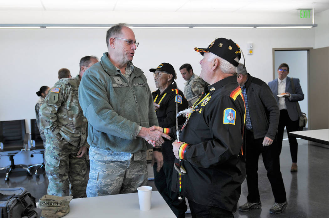 Special to the Pahrump Valley Times Brig. Gen. William Burks greets Piute spiritual leader Ralph Burns during the event. As is Nevada Guard custom at building unveilings, four representatives from ...