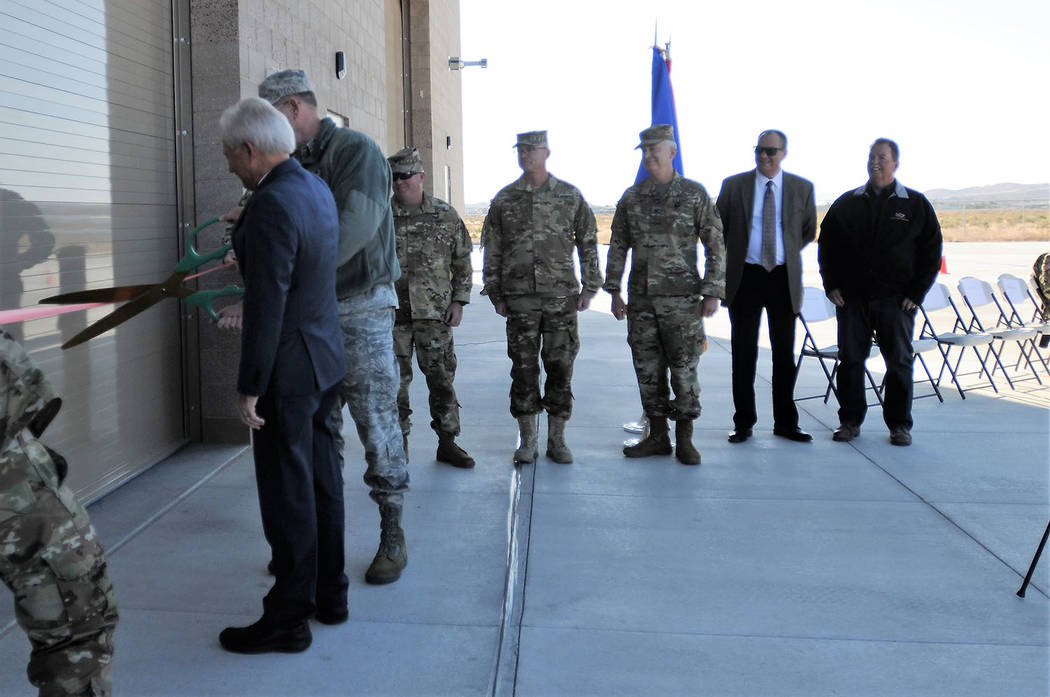 Special to the Pahrump Valley Times Brig. Gen. William Burks cuts the ribbon on the $8 million shop. Burks said the nation's other adjutants general are envious of the Nevada Guard expanding inf ...