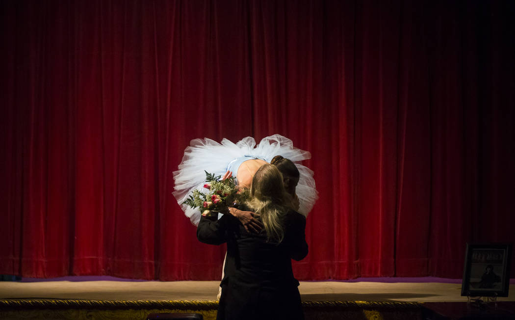 Hank Humphreys, a longtime friend of Marta Becket, gives a hug and a bouquet of flowers to Hilda Vazquez after her season-opening performance at the Amargosa Opera House in Death Valley Junction,  ...