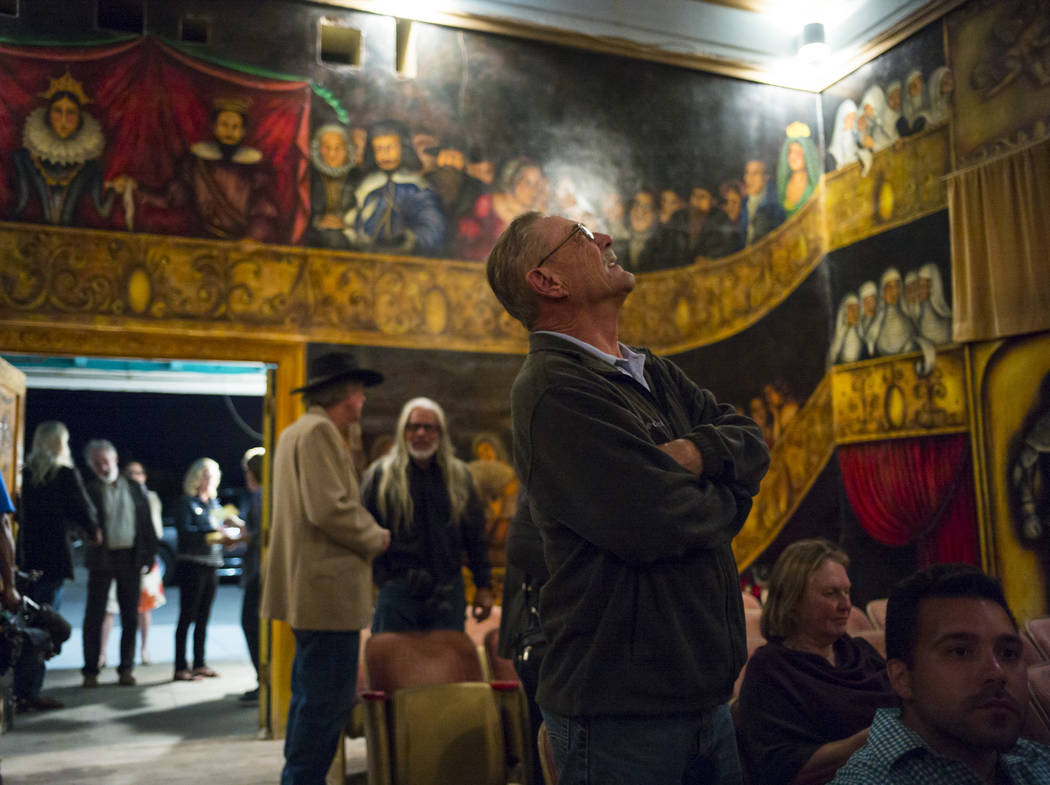 Attendees take in the scene of the painted walls and ceiling, which was done entirely by Marta Becket, before the season-opening performance at the Amargosa Opera House in Death Valley Junction, C ...