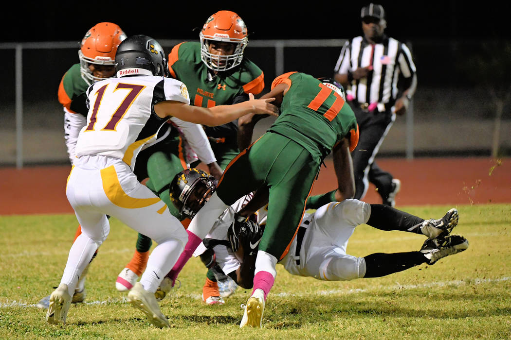 Peter Davis/ Special to the Pahrump Valley Times Casey Flennory goes down after making some big yardage during the Mojave game last week.