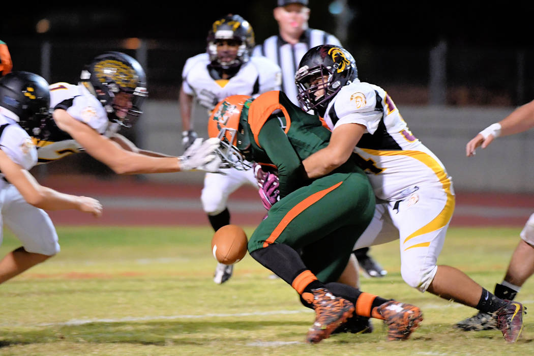 Peter Davis/ Special to the Pahrump Valley Times Nico Velazquez causes a fumble on this play as he tackles a Mojave player in last week's game. The Trojans advance as the fourth place seed and pla ...