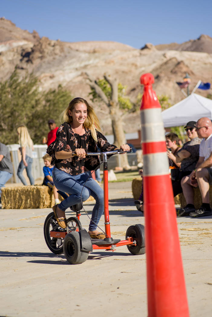 Skylar Stephens/Special to the Pahrump Valley Times Alexandria Lavasseur rides in the tricycle races during Beatty Days on Oct. 27, 2017. The three-day festival brought out several entrants into a ...