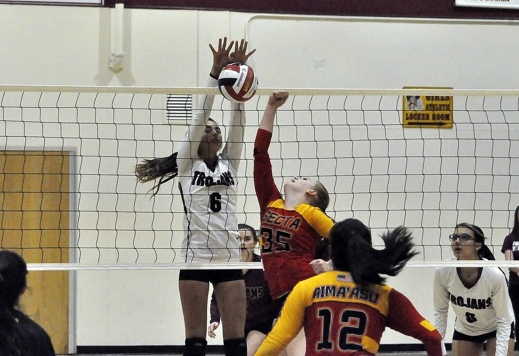 Horace Langford Jr./Pahrump Valley Times  Freshman Nicky Velazquez blocks a ball against Tech in the first round of playoffs on Tuesday that saw the Trojans winning after five sets. They played Bo ...