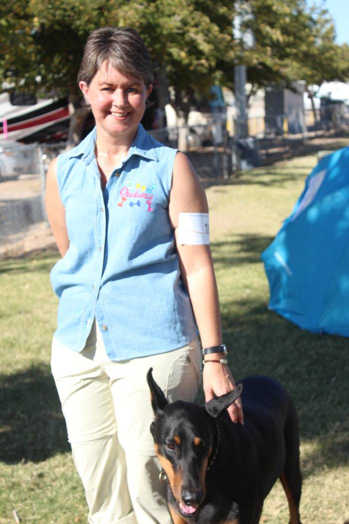 Jeffrey Meehan/Pahrump Valley Times Janet Wagner (left), stands next to her doberman pinscher Bakar's Ready for the Ride (right), who won first place in the preferred novice class for obedience in ...