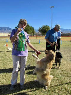 Mary Foley/Special to the Pahrump Valley Times Marina Pavlovsky (left), member of the Vegas Valley Dog Obedience Club, stands with her dog Dexter at the 10th Annual Obedience & Rally Trials, p ...