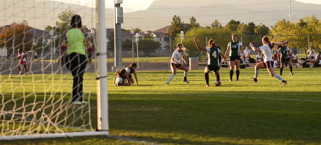 Skylar Stephens/Special to the Pahrump Valley Times  Vaniah Vitto in headband and to the left with teammate Kaitlyn Carrington (right) going after the ball on Wednesday at the Bettye Wilson Soccer ...
