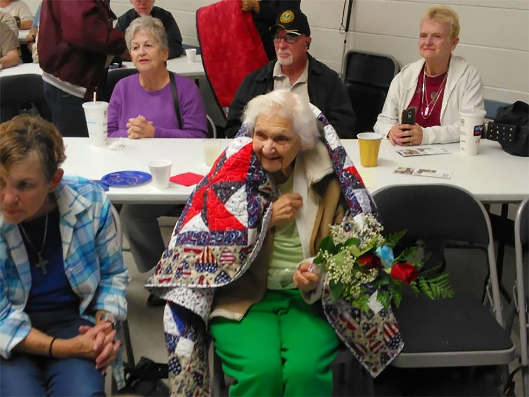 Selwyn Harris / Pahrump Valley Times  U.S. Navy Veteran Pauline Pavlick 95, was a recipient of a Quilt of Valor during a presentation at the Bob Ruud Community Center last year. This year's pres ...