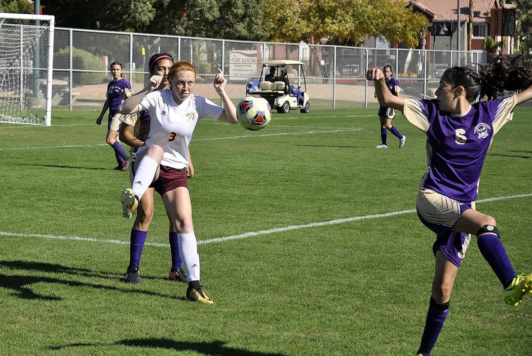 Horace Langford Jr./Pahrump Valley Times -  Kaitlyn Carrington receives a pass during the regional championship on Friday