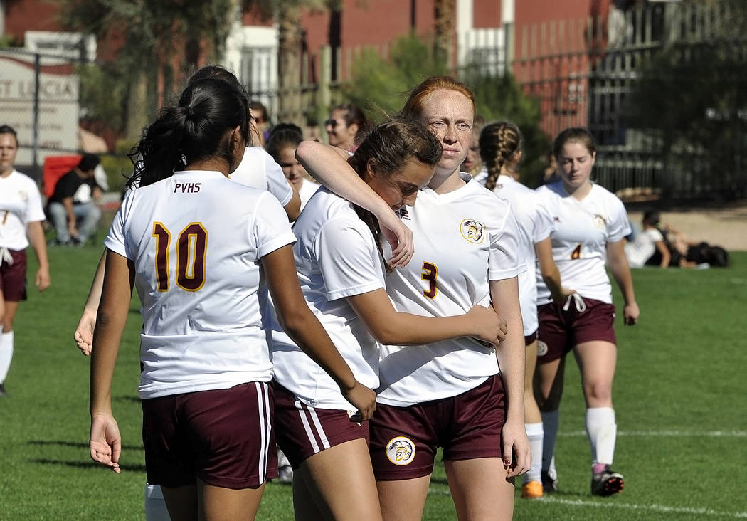 """Horace Langford Jr./Pahrump Valley Times - """"Kaitlyn Carrington is comforted by Kenya Vanderbeek after the game. The Trojans will play Truckee on Friday at 2 p.m. at Spanish Springs High School."""