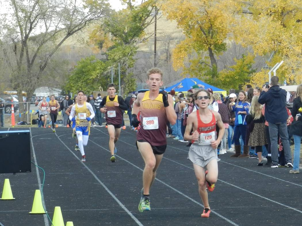 Special to the Pahrump Valley Times Senior Layron Sonerholm finishes strong in his last meet of this career with the Trojans. He finished 34th (19:14).