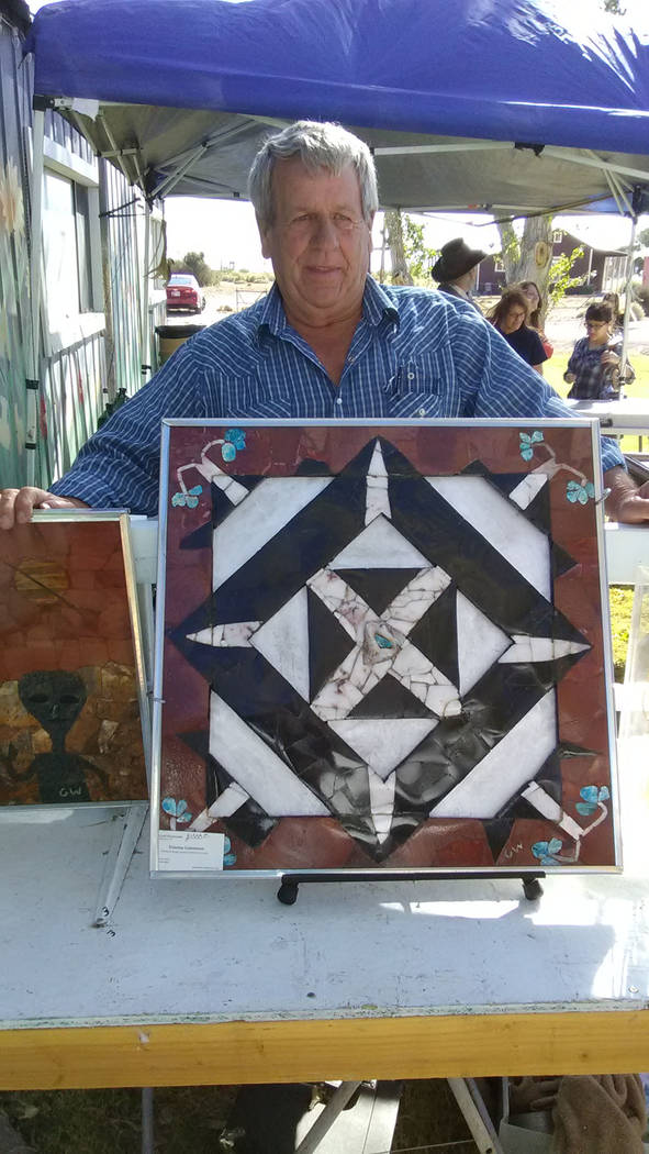 Selwyn Harris/Pahrump Valley Times  Artist Geoff Wordsworth displays some of his handmade artwork during Old West Days on Saturday. Wordworth specializes in finished and rough gemstones, rock art  ...
