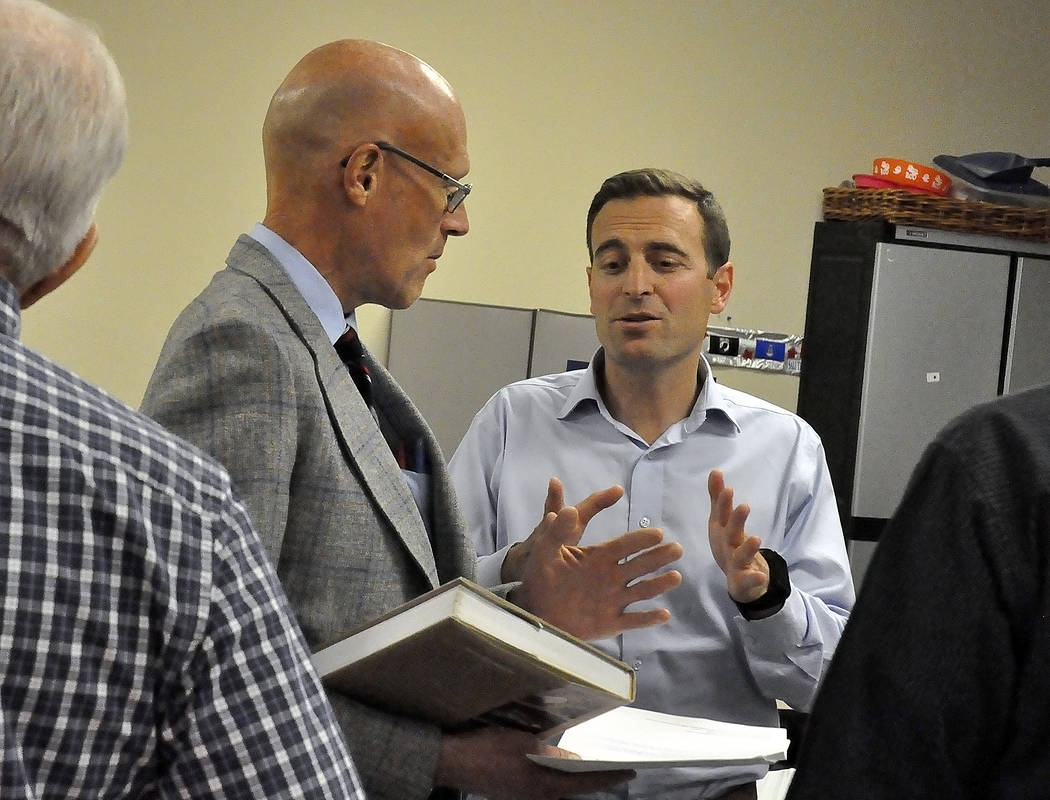 "Horace Langford Jr./Pahrump Valley Times  Bill Stremmel, of Cybertran International, shows Nevada Attorney General Adam Laxalt a book on Yucca Mountain project titled ""A Waste of a Mountain."" Laxa ..."