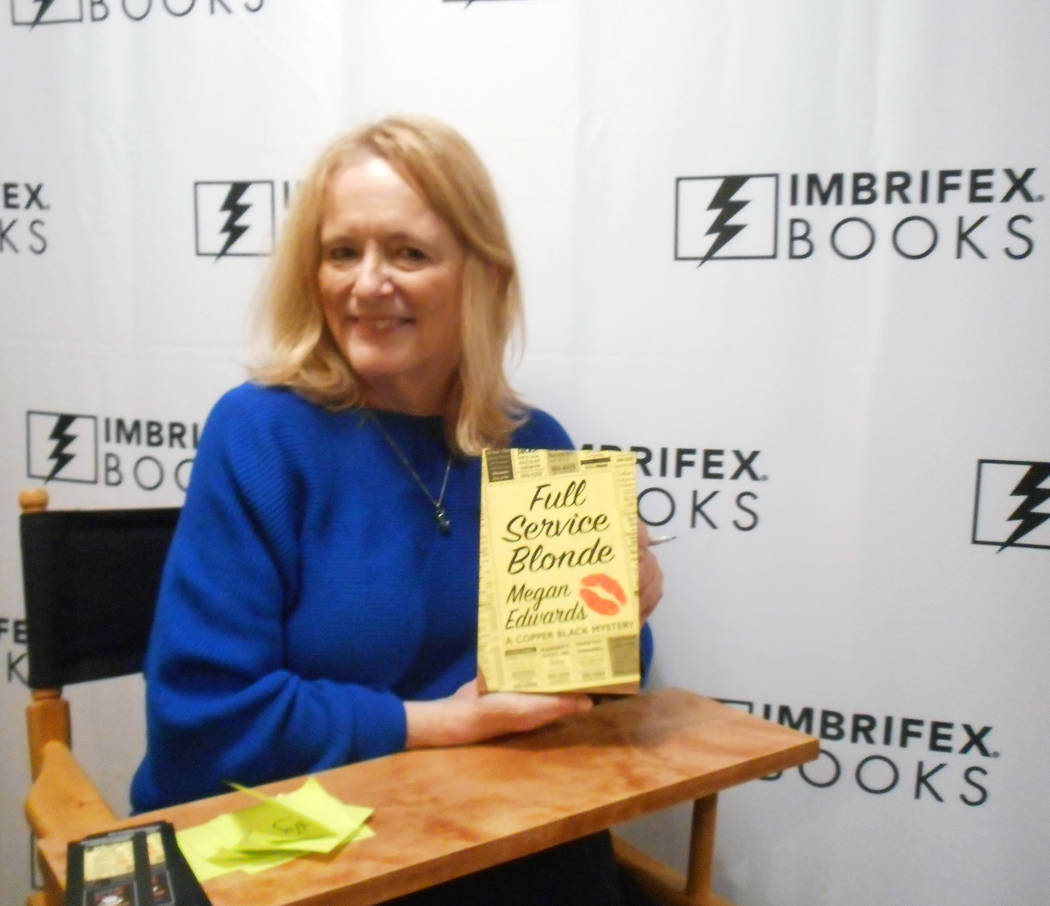 "Megan Edwards displaying her novel ""Full Service Blonde"" at the Writer's Block bookstore in Las Vegas on Tuesday, November 7."