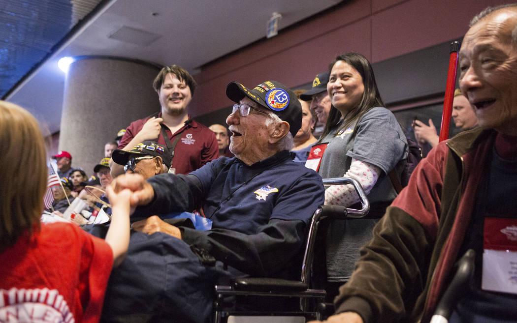 Elizabeth Brumley/Las Vegas Review-Journal  World War II Veteran Joe Pena is greeted at McCarran International Airport after returning to Las Vegas from Washington, D.C. from an Honor Flight South ...