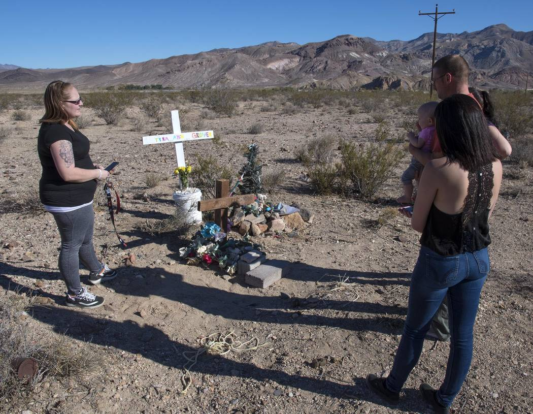 Special to the Pahrump Valley Times Jordahnah Toviah Grover (left), mother of 14-year-old daughter, Tyra Welch Grover, who died in a car crash in 2015, stands at the memorial site on Oct. 24, 2017 ...