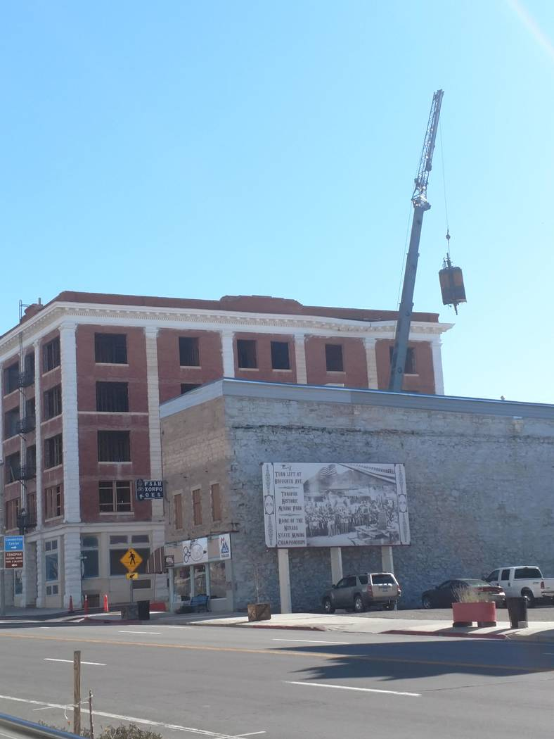 Special to Times-Bonanza A crane can be seen lowering the elevator at the Belvada at 101 S. Main St. in Tonopah in October 2017. The building was built in 1906 and had been blighted by the town of ...