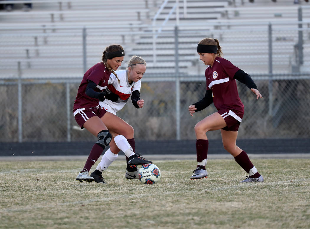 Hans Baumann/Special to the Pahrump Valley Times Vaniah Vitto fights for the ball with a Wolverine player on Friday at Spanish Springs High School. The girls lost the semifinal game in double over ...