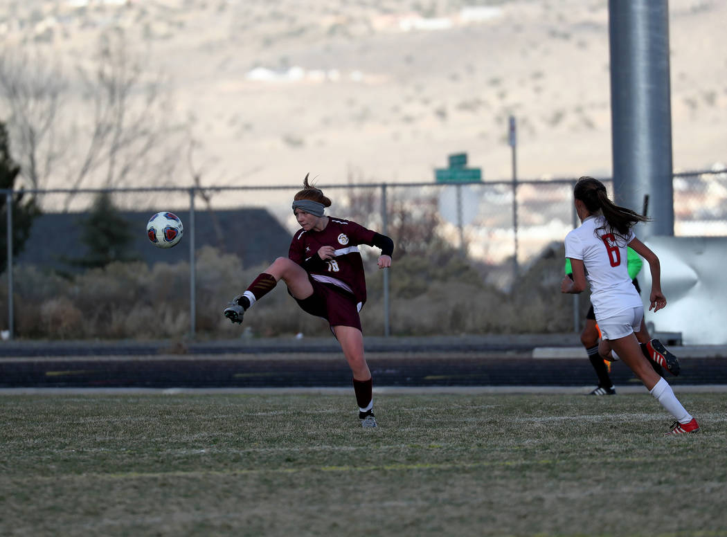 Hans Baumann/Special to the Pahrump Valley Times Freshman Makayla Gent knocks down a ball against Truckee on Friday at the Class 3A state soccer semifinal game at Spanish Springs. Gent was the thi ...