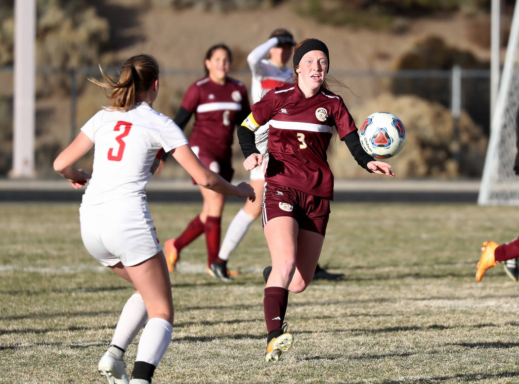Hans Baumann/Special to the Pahrump Valley Times Senior Kaitlyn Carrington chases down a ball against Truckee at the state semifinal last week. Carrington had 18 goals this year and was a close se ...