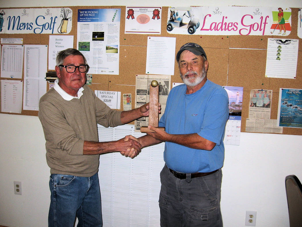 Special to the Pahrump Valley Times Ed Plavac, (Left)tournament director, Presents the  Lakeview Men's Club Tournament  trophy to Spencer Matlock.