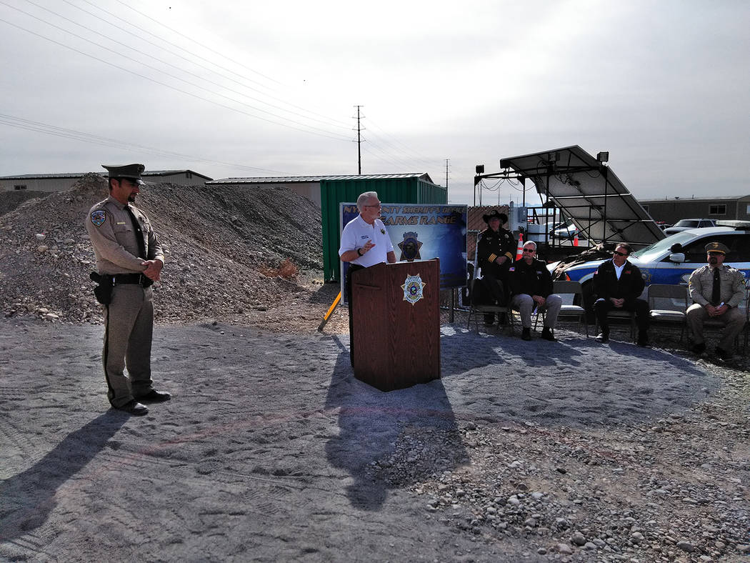 Selwyn Harris/Pahrump Valley Times  Chaplain Gene Hall provides a closing prayer toward the end of Monday's target range unveiling, as Nye County Sheriff's Office Sergeant Adam Tippetts, left, ...