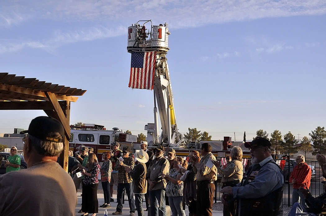 Horace Langford Jr./Pahrump Valley Times Pahrump Valley Fire and Rescue Services, Chief Scott Lewis furnished the department's Tower Ladder for the Veterans Day ceremony at the veterans section  ...