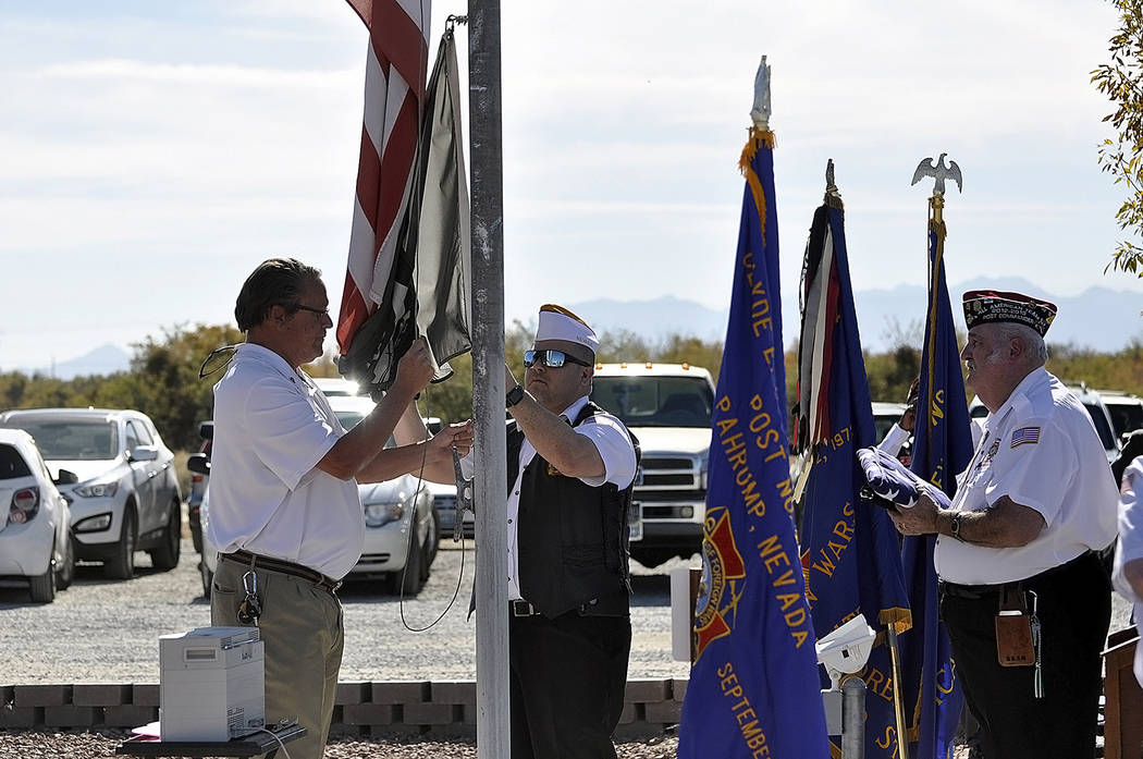 Horace Langford Jr./Pahrump Valley Times -  Veterans Day ceremony held at VFW Post 10054, Post Commander Tom Vick prepares to replace the retired flag.